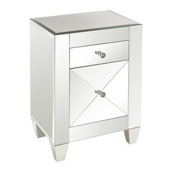 "Worlds Away - Worlds Away Marina Mirrored Nightstand - Worlds Away touches the home with marvelous of-the-moment treasures inspired by vintage finishes, patterns and styles. A contemporary design, the Marina nightstand offers bedrooms shimmering glamour. Crafted with a striking beveled mirror exterior, this bedside table features one small glide drawer and one storage space with a door. Clear glass knobs provide an elegant finishing touch. 19""W x 14""D x 26""H."