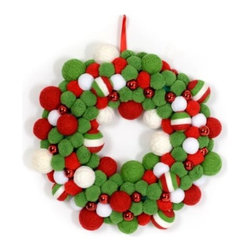 Red & Green Yarn Wreath - Keep it whimsical. If little ones are underfoot, this wreath is a huge hit. There is something about pom-poms that makes everyone smile. Add this to a child's room or playroom for an instant dose of Christmas cheer.