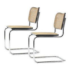 """Consigned style cane chairs set of 2 - This is a great reproduction of the original cesca chair, here is a little background about the design: """" In a bold design moved based on the tubed frames of bicycles, Breuer began to experiment with tubular steel furniture. A major player in the Bauhaus movement, and a protégé of Walter Gropius, Breuer designed such classics as the Wassily chair. The Cesca Chair is a stunning piece of history no matter what its context. It's handwoven cane seat is a great detail that makes this chair very modern, but transistional at the same time."""