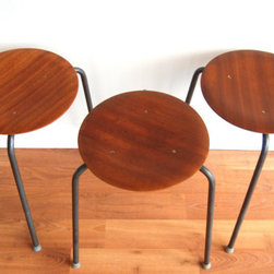 Arne Jacobsen Teak Stool (3 Available) - A rare set of bent teak Dot stools by architect and designer Arne Jacobsen for Danish furniture company Fritz Hansen. These chairs are a very early edition of this iconic design, produced in the 1950s.