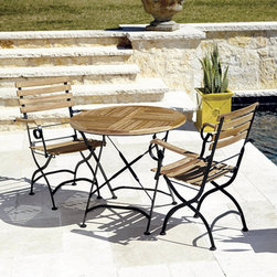 Ballard Designs - Giardino 3-Piece Cafe Dining Set with Armchairs - Folds for easy set-up & storage. X-stretchers & subtle twist details. Use of an outdoor furniture cover is recommended to extend the life of your piece. Our Giardino Cafe Set the look and surprising comfort of those charming caf&#233 tables and chairs you see dotting the sidewalks of Europe. Frames are crafted of rust-resistant, powder-coated iron and fitted with thick slats of naturally weather-resistant and insect-resistant teak. If left untreated, teak finish will develop into a warm silvery gray patina over time. Set includes Cafe Table and two Armchairs. Giardino Cafe Set features:. . .