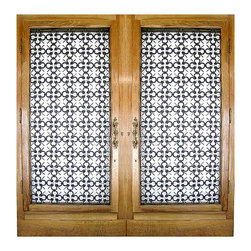 Pair of Detailed Antique- Consigned Double Entry Doors with Inset Iron Grates - Height: 89.5 in. (227.33 cm)