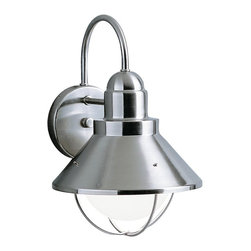 BUILDER - BUILDER Seaside Lodge/Country/Rustic/Garden Outdoor Wall Sconce X-IN2209 - Brass construction finished in a Brushed Nickel hue gives this Kichler Lighting outdoor wall sconce a modern, urban and industrial feel. From the Seaside Collection, the cone shape of the shade and the clean lines allow it to seamlessly blend into a number of home styles. U.L. listed for wet locations and Dark Sky compliant.
