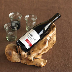 """Viva Terra - Root of the Earth Wine Caddy - We've preserved the fascinating  natural swirls, imperfections,  deep patina and sculptural contours  of the Chinese burl and scooped  out a smooth bottle rest to create  this distinctive wine caddy. Each  piece unique. APPROX. 12""""L x 8""""W x 6""""H"""