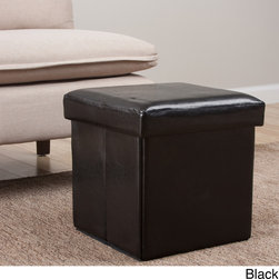 None - Square Folding Faux Leather Storage Ottoman - Style and function combine to create this beautiful folding storage ottoman. The attractive black faux leather upholstery on this ottoman complements many living spaces.