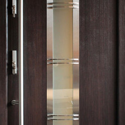 "Modern Front Entry Door - ""Madrid"" - modern entry door in wenge finish. The door is constructed with aluminum frame for higher thermo insulation and absolute rust protection. Stainless steel door slab with decorative glass inserts make it look irresistable. 3 point locking system is added for extra security. The door is suitable for installations in Coastal Regions with high risk hurricane. The price includes complete set. Sidelites and transom are available at extra cost. For more information visit www.villedoors.com"