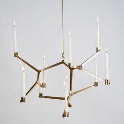Agnes Hanging Candelabra - Although the use of candles to save energy can be debatable, I find that they are great mood setters and perfect for those times you just need a little light. This chandelier is beautiful and would be perfect above a dinner table.