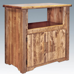 "Montana Woodworks - Homestead Utility Stand, Stained and Lacquered - From Montana Woodworks, the largest manufacturer of handcrafted, heirloom quality rustic furnishings in America comes the Homestead Collection line of furniture products. Handcrafted in the mountains of Montana using solid, American grown wood, the artisans rough saw all the timbers and accessory trim pieces for a look uniquely reminiscent of the timber-framed homes once found on the American frontier. This delightful, rustic style utility cabinet is truly multi-functional in design and use. Skilled artisans carefully handcraft this cabinet to ensure an heirloom quality piece you can rely on for generations to come. A large, 27""W x 14""D x 14""H storage area is nicely concealed behind two raised panel doors. The open area above the top measures 24"" W x 14"" D x 6"" H. Comes fully assembled. 20-year limited warranty included at no additional charge. Hand Crafted in Montana U.S.A.; Solid, U.S. grown wood; Timbers and Trim Pieces are Sawn Square for Rustic Timber Frame Design Appearance; Heirloom Quality; 20 Year Limited Warranty; Durable Build, Fit and Finish; Each Piece Signed By The Artisan Who Makes It; Solid Wood, Edge Glued Panels; Solid genuine lodge pole pine Trim and Accents. Dimensions: 31""W x 16""D x 26""H"