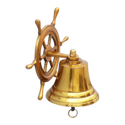 """Handcrafted Model Ships - Ship Wheel Brass Bell 7"""" - Small Brass Hanging Bell - Elegantly designed and gleaming with a lustrous shine, this fabulous Brass Hanging Ship Wheel Bell 7"""" is equally stunning indoors or out. In addition to being fully functional, this ships bell is a great addition to any nautical decor themed room. Make a nautical wall decor statement and enjoy this wonderfully decorative style and distinct, warm """"strike through"""" nautical tone with each and every resounding ring."""