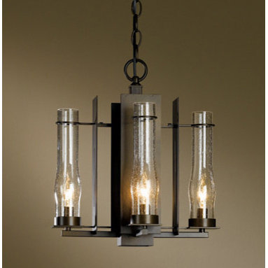 New Town 4-light Chandelier by Hubbardton Forge - New Town 4-light Chandelier features a seeded clear glass with the choice of bronze, black, dark smoke, burnished steel, natural iron, or mahogany finishes. Four 60-watt, 120 volt B10 candelabra base incandescent buls are required, but not included. Dimensions: 14.1W x 15.4H. Suitable for Damp Location.