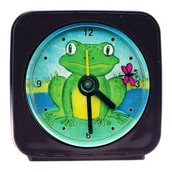Little Toad Alarm Clock - Great for kids or adults, our alarm clocks can't help but make you smile. Made from an original painting, each clock is 2'' square with a round face. The second hand is a small image, which appears to float magically above the clock face. On the Little Toad Alarm Clock, a tiny dragonfly flies around the toad as it counts the seconds. Each alarm clock comes in a gift box and includes a free battery. Made in the USA. (Be sure to look for our frog-themed wall clock, nightlight and magnets, too!)