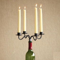 WINE BOTTLE CANDELABRA, SET OF 2 - This pair of candelabras from Sundance is the perfect hostess gift for an oenophile, and provides a great way to reuse an empty wine bottle.