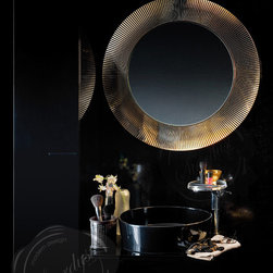 Kartell All Saints Round Wall Mirror - Kartell All Saints by Laufen Design, a modern wall mirror with a circular shape that is beautiful enough to be used as an art piece.  Starting at $340 for the transparent edition in either crystal, amber or tangerine orange.  Available from: http://www.stardust.com/kartellallsaints.html