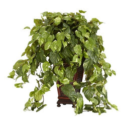 Vining Pothos with Decorative Vase Silk Plant - Is there anything that adds a touch of nature sure to brighten up an otherwise sterile area better than an overflowing Pothos silk plant? We didn't think so either. Set in a decorative brown container, the detailed design peeks out as the Pothos plant spills out in an avalanche of greenery providing a rich contrast of colors. Plus it stays green without a single drop of water! Height= 36 in x Width= 28 in x Depth= 25 in