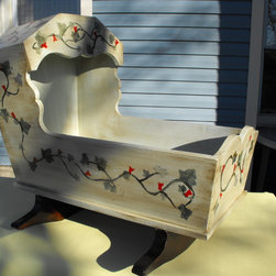 "Vintage baby craddle - I took this vintage rocking craddle and faux finished it to match its period. I used a latex  light pastel green paint  then i rubbed in a dark stain. Then I sealed it all with a satin poly. This beautiful craddle stands 31"" tall and 32"" long by 22"" wide. It was originally made from pine and stained a med color."