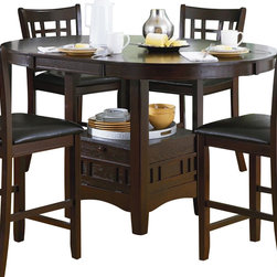 Homelegance - Homelegance Junipero Extension Counter Height Table w/ Storage Base - Utilizing the traditional elements of Mission styling, the Junipero Collection adds the feel of the early 20th Century design movement to your casual dining room. The pedestal table base supports an oval top and features storage accessible behind the drop-panel door. Framing, unique to the classic style, carries from the chairbacks to the table base. The rich brown finish serves to highlight the wood veneer.