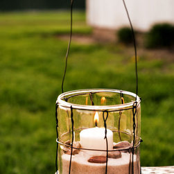 Glass & Wire Hanging Lantern by Soiree Supply - I love the simplicity of this lantern. It's very understated and yet so chic.