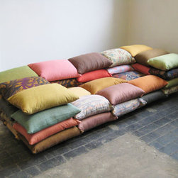 Cushionized Sofa - I don't think there could be a more cozy-looking sofa. Designer Christiane Hoegner hit it on the spot with stacked pillows and a deep seat.