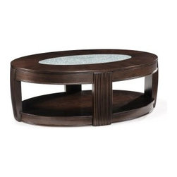 Magnussen T1738 Ino Wood and Glass Oval Coffee Table with Casters - The Magnussen T1738 Ino Wood and Glass Oval Coffee Table with Casters is a contemporary-style piece that has a wide, wonderful look that brings new life to any furniture set you add it to. Its sturdy frame is constructed from select ash veneers and fine hardwood solids, and then given an alluring burnt umber finish that brings out the richness of the wood. An ovoid cracked glass insert is inset in the center of the table's top, providing a bright contrast to the dark color of the piece. A lower display shelf and caster wheels round out the design.About Magnussen FurnitureFrom its beginning as a small furniture company in Ontario, Canada, Magnussen Furniture has evolved into a full-line furniture resource with offices in Canada, the United States, and the Far East. Their business is creating furniture designs of exceptional style, value, and beauty. They produce these designs in partnership with manufacturing partners around the world that meet exacting standards for superior quality at the best possible value.