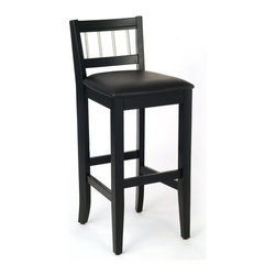 HomeStyles - Pub Stool in Black Finish - Entertaining will be easier when you have the visual appeal of this pub stool. The low profile back features stainless steel insets that are a perfect pairing with the black finish. Add a matching table for a complete look that will draw attention to a modern space. * Contemporary style. Cushioned black vinyl seat. Stainless steel finished rungs. Clear coat finish to guard against wear and tear stemming from normal use. Made from Asian hardwood and solid wood. Made in Thailand. Seat height: 24 in.. Overall: 20 in. L x 17 in. W x 40.25 in H. Assembly instructions