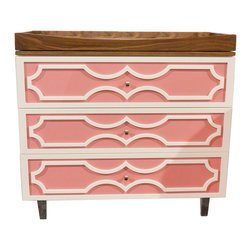"Nursery Works - PetitNest Peony Dresser - PetitNest's innovative approach to furniture combines sustainable practices with fresh style to children's spaces. Exuding modern flair, the Peony dresser delivers functional and sophisticated storage to a bedroom or nursery. Set on four round acrylic legs, this eclectic furnishing delights with eye-catching curvy moldings on three drawers with soft-close hardware. Available in a pink or Dior gray finish. Choice of walnut or white trim. Finish is non-toxic, water-based and VOC-free. 42""W x 20""D x 35""H ."