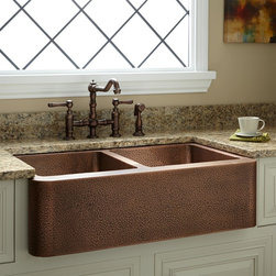 """35"""" Double-Bowl Hammered Copper Farmhouse Sink - The hand-hammered bowls of this sink offer a sharp contrast of shadows and highlights, making it not only a useful kitchen aid, but a piece of art as well. Perfect for those who desire both functionality and aesthetics."""
