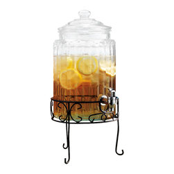 "Home Essentials - Glass Ribbed Beverage Dispenser With Stand - Keeps out of sticky situations, and have your party buzzing with punch and fun in our spectacular Glass Infusion Ribbed Beverage Dispenser.  It Boasts  an etched ribbed design, and rests on an elegant wrought iron black stand.                                                  * Capacity:1.5 Gallon                          * Dimensions: Height 16"" and width is 12""."