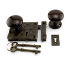 """Ornate Solid Brass Rim Lock Set with Brown Porcelain Knobs - This solid brass, turn of the century reproduction rim lock features skeleton keys and a slide bolt. The design includes the number 20 wrapped with a """"C."""""""