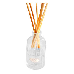 Coral Boxed Scent Diffuser - The simple look of an apothecary jar contains a home fragrance oil with pleasing complexity: warm, zesty citrus top notes adding vigor to rich pomegranate rooted in the dry sweetness of vetiver and musk. The Coral Boxed Scent Diffuser is packaged in a naturalist-inspired box, complete with a collection of pale, slender reeds to disperse the elegant scent of the blend.