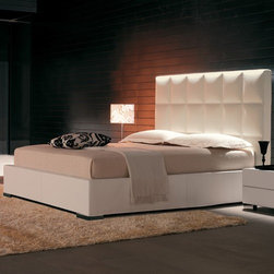 Cattelan Italia - Cattelan Italia | William Bed - Made in Italy by Cattelan Italia. Sleep like a royal on the kingly William Bed, which even a prince would find aesthetically appealing. Showcasing Italy's heritage of premium craftsmanship and enduring quality, this welcoming and irresistible bed features a towering headboard with plush cushioning underneath soft, fine leather that's set in an elegant square design. Completing the luxurious look is the fully upholstered timber body, which offers superior support and comfort at the same time. Options for size as well as leather color and style offered. Ideal for master or formal bedrooms and hotel suites. Bed with storage also available.