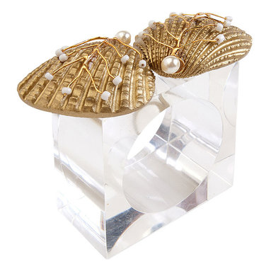 Sand Dollar Napkin Ring - It would be an enchanting addition to a tablescape in a summerhouse, a seaside bungalow, a dining room that boasts a touch of the nautical; such is the versatility of the Sand Dollar Napkin Ring. Two gold shells adorned with petite pearls that seem to have been gifted by the sea sit atop a simple square base.