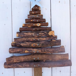 Souvenir Farm, Ltd. - Rustic Reclaimed Wood Christmas Tree - Add some rustic charm to your holiday decor with this one-of-a-kind handmade tree. Built from tree branches and barn wood and topped with a silver star, it brings cozy Christmas cheer to any space — indoors or out.