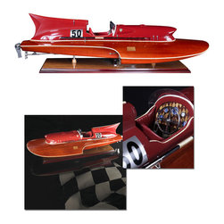 """Inviting Home - Thunder-Boat Model - Thunderboat model is hand-made by skilled craftsman outstanding quality replica of very popular 1950s hydroplane. Model boat have highest quality parts including meticulously detailed cockpit; all metal hardware made from individual molds. Thunderboat model comes with table stand; 31-1/2""""L x 11-3/4""""W x 9""""H The Jaguar XK120 ruled the road; Doris Day and Cary Grant were Oscar nominated. It was a time of peace and optimism was unbridled� It was then that Rivas roared across the Lago di Como and skimmed the Mediterranean waves off St. Tropez. Thunder-boats (also called Hydroplanes) racing with each other at record speed. Stateside the luxurious Chris Crafts were de rigeur with Hollywood elite. The throaty growl of that big engine built inside gleaming mahogany rich leather chrome trim. Leather padded seats displayed movie stars trying out the new bikini fashions. Husband number 3 4 or 5 behind the wheel decked out in spotless captain�s finery. No Coast Guard was able to overtake these sleek twin-engine torpedo shaped racers. This boat has it all-the curves the looks the excitement the opulence�"""
