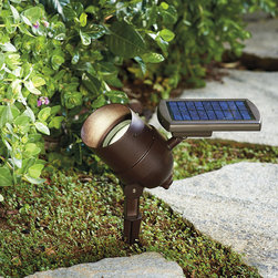 Frontgate - Smart Focus Solar Spotlight - Delivers 50 lumens of super-bright light. Powered for up to 8 hours by the attached crystalline solar panel. Powdercoated die-cast aluminum housing ensures lasting durability. Includes two AA lithium-ion rechargeable batteries and a cast aluminum stake for placement. View instructions for use. Whether you're highlighting a single landscaping piece or simply illuminating the front of your home, this adjustable solar light goes from tightly focused beam to a wide beam with the twist of a dial.  .  .  .  . .