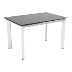 Euro Style - Turi Glass Table - Clear glass top and industrial strength base make Trave the first name in lasting style.  The statement is crisp lines and clear strength.  Sitting or standing room only!