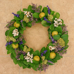 Frontgate - Apple Delight Wreath - Crafted from a mix of fresh, air-dried, and faux materials. Designed for indoor display. If displayed outdoors, hang in a covered area, away from direct sunlight. Welcome visitors with a delectable display of fruit, foliage, and flowers. Our classic wreath starts with a base of fresh salal leaves, structured with a wire frame. Dried gatherings of white winged everlasting, purple sea lavender, and reindeer moss pair up with green faux apples, creating an arrangement ideal for any season.. . .