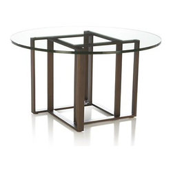 Tory Round Coffee Table - Clear glass tabletop gives a clear view of the intriguing intersection of open squares down under. Tubular stainless steel frame with an antique brass finish adds unexpected interest and lots of design possibilities.