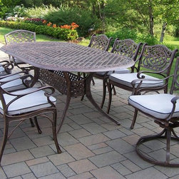 Oakland Living - Mississippi 9-Pc Oval Patio Dining Set - Includes one table, six dining chairs with cushions and two swivel rockers with cushions. Fade, chip and crack resistant. Traditional lattice pattern and scroll work. Brass hardware. Warranty: One year limited. Made from rust free cast aluminum. Hardened powder coat finish in antique bronze. Minimal assembly required. Table: 84 in. L x 42 in. W x 29 in. H. Dining chair: 23 in. W x 22 in. D x 35.5 in. H (23 lbs.). Swivel chair: 23 in. W x 17.5 in. D x 38 in. H (66 lbs.)This dining set is the prefect piece for any outdoor dinner setting. Just the right size for any backyard or patio. The Oakland Mississippi Collection combines southern style and modern designs giving you a rich addition to any outdoor setting.