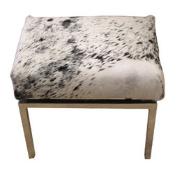 Cowhide Upholstered Stool or Ottoman - A more traditional twist on the cowhide vanity stool, this would also be great in rooms other than the bathroom. Try it in a living room or bedroom.