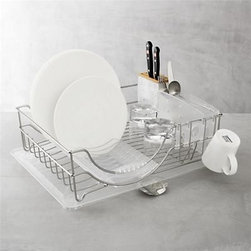 "simplehuman® System Dish Rack - Thoughtful modern dish-drying design from simplehuman® isn't just stylish, it's a high-functioning ""tool for efficient living."" Customized rack includes detachable plate-drying tray; deep utensil holder with bamboo knife block that holds knives upright with blades covered; cup holders; and pour spout that combines with quick-flip feet for fast, directed draining. Extra-long shape with deep sides mean high capacity – up to 14 plates or rimmed bowls."