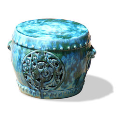 China Furniture and Arts - Porcelain Garden Stool - With an antique drip-mottled glaze finish, our handcrafted earthenware stool was adopted from those originally used in the temple garden in the Far East. The hand-applied finish creates variations in its color making each seat distinct with individual signature. Can be used indoors and outdoors as a small end table or as seating. Imported.