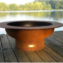 "Fire Pit Art Saturn Outdoor Fire Pit with Optional Lid - The Fire Pit Art Saturn Outdoor Fire Pit with Optional Lid has a wide-rimmed bowl perfect for folks who love to prop their feet up to the fire or set their mug near the fire on a chilly night. This large outer ring is how it gets its name """"Saturn,"""" and this large 40-inch fire pit is indeed planetary! It's more than big enough to get a large fire going that'll warm you and your party and create some lovely ambient lighting. No two Fire Pit Art pits are alike! Each one is hand-cut and crafted, then fitted with a brass plate at its base with designer Rick Wittrig's name. Constructed of heavy-gauge, quarter-inch-thick carbon steel, the Fire Pit Art Saturn Outdoor Fire Pit has been forged to bring you years of heavy use. The exterior is coated in a protective iron oxide finish that comes in a vibrant patina color. The interior is lined in high-temperature paint and has a 1.5-inch rain drain in the bottom so you won't ever have stagnant water after a rainstorm. No maintenance is required. Spark guard, stone ground base, and log rack sold separately."