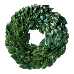 Magnolia Company - Fresh Magnolia Wreath - Simplicity at its finest! Our beautiful all green magnolia wreath hand-crafted from grandiflora hidings its rich copper undersides. Glossy green leaves create a dramatic monochromatic look. A best-seller every year!