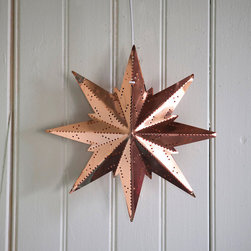 Copper Snowflake Lantern - How gorgeous would this star lantern be for the holidays? I would hang a set of three at different heights above my Christmas tree.