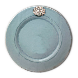 Coquille Dinner Plate - Mist - Serve in subtle grandeur with the Coquille Dinner Plate in Mist, an artisan-glazed stoneware piece with a proud, richly-detailed scallop medallion in pewter adorning its top.  The metallic accent both draws out the several delicate water tones of the blue-grey, hand-applied glaze and adds a sense of heirloom-quality richness to this stunning tabletop choice.