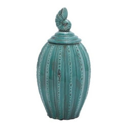 Blue Ceramic Jar - Whether it sits in the bathroom or the kitchen, the Ceramic Jar Complements The Rustic and Antique Decor with style. It's crafted of high-quality ceramic and finished in a rich, glossy blue hue that's sure to draw the eye with its striped pattern and weathered effects. Best of all, a seashell finial tops off the lid.