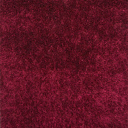 "Flux FL20 Rug - 3'6""x5'6"" - Personal expression reaches new heights with Flux, a beautiful range of plush, hand-woven shag rugs of 100% polyester. This ��_chameleon��_ is ideal for the contemporary design lover who enjoys mixing up his or her personal space often ��_ acting as a rich background to a diverse palette of furnishings and accessories. Highly textured shag construction brings comfort underfoot while a palette of fashionforward solid hues commands attention in any room."