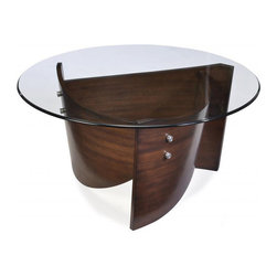 Magnussen Home Furnishings - Contour Wood and Glass Top Round Cocktail Table - Spruce up your living room with this lovely modern cocktail table. This piece features wood-and-glass construction with a contoured base, making it an excellent conversation starter. A circular glass tabletop completes this contemporary look.