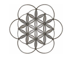 Uttermost - Baiano Decorative Metal Mirror - If you liked looking into a kaleidoscope as a kid, you'll love gazing at this mirrored wall hanging. Crafted of hand-forged metal, the antiqued look comes via the burnished, silver leaf finish. Hang it as a decorative accent in a living room or bedroom for a touch of glimmer.