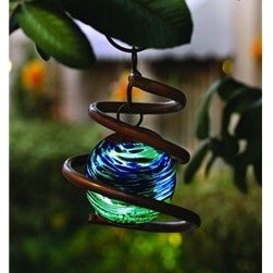 Illuminaries Glow in The Dark Coiled Sun Catcher - This is super cool. The beautiful glass globe has crystals that will absorb sunlight during the day and glow for up to 4 hours at night. I like this because it looks great hanging in the light by day and adds visual interest at night.